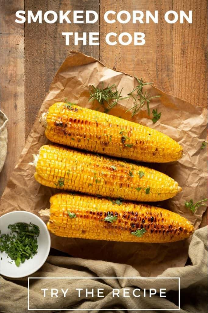 Smoked corn on the cob on a wooden table