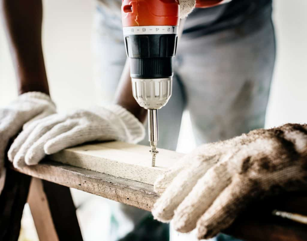 person drilling wood