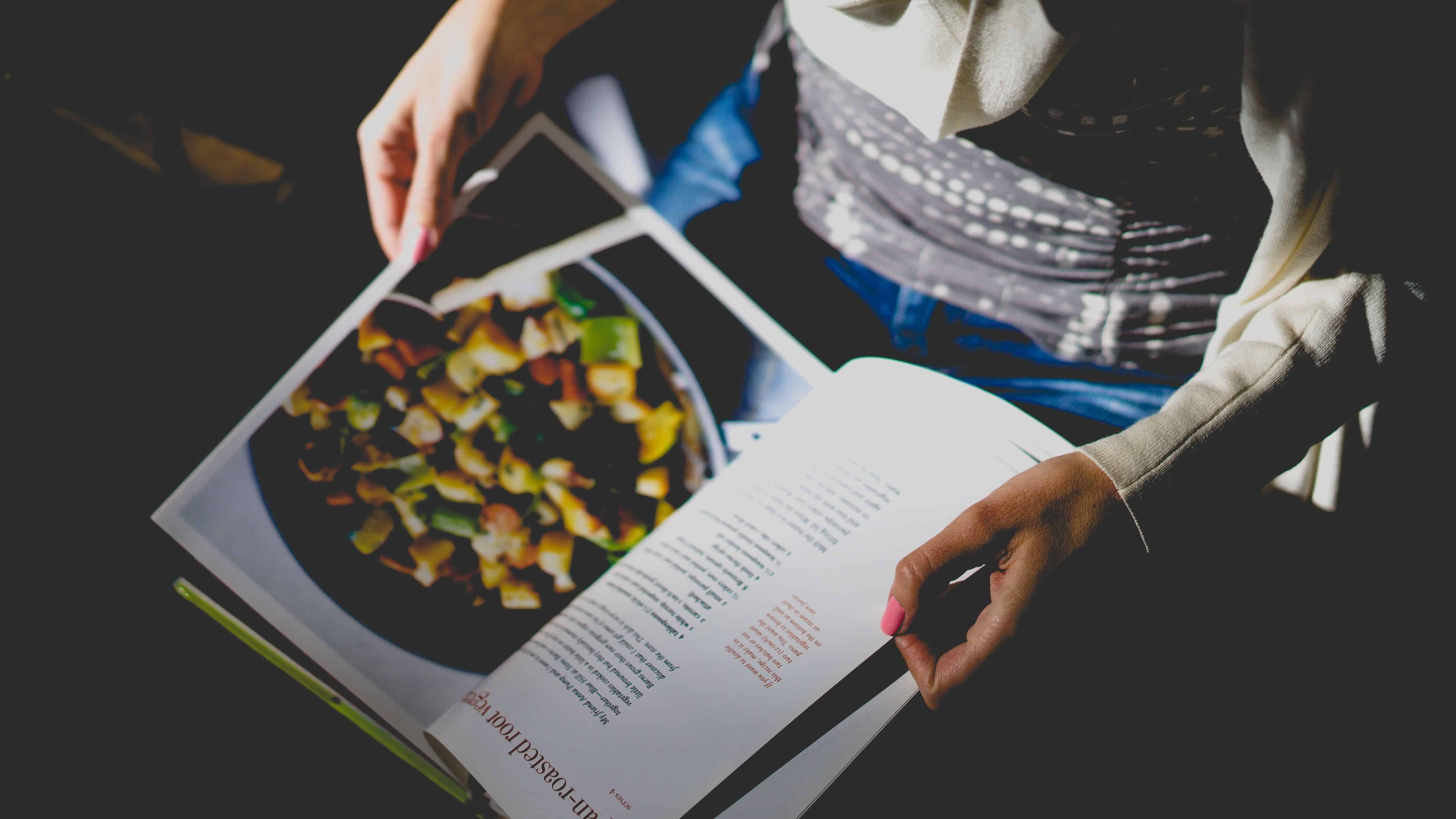 a person is reading a cookbook