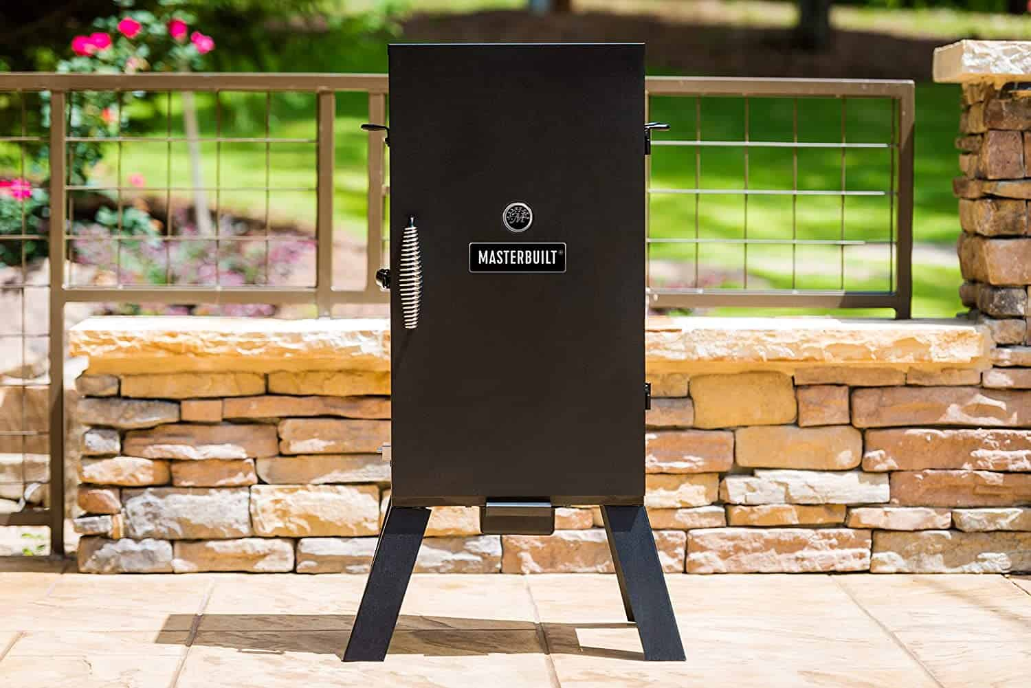 Best electric smoker for ribs (for beginners)- Masterbuilt MB20070210 in garden