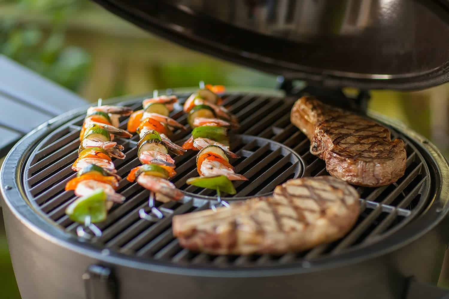 Most budget-friendly Kamado grill- Char Griller Akorn cooking meat