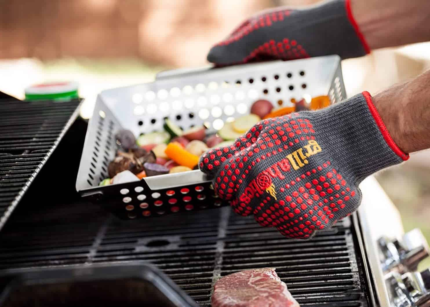 Best silicone BBQ gloves- Grillaholics Silicone Barbecue Gloves grabbing grill basket